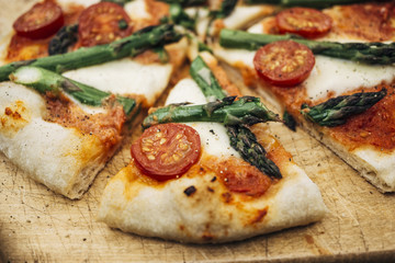 Food: Homemade Pizza with green asparagus and cherry tomato