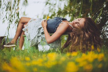 Girl laying on a bench and relaxing outdoors