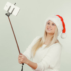 Woman in santa hat taking selfie