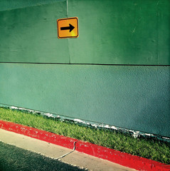 Directional arrow sign on wall