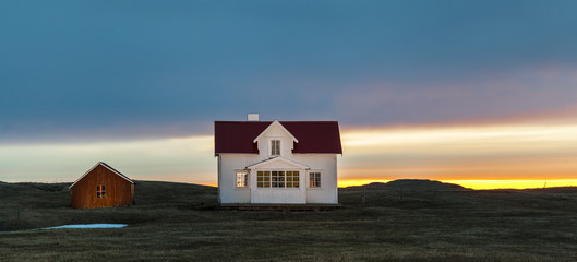 Norwegian beautiful house lit by the midnight sun