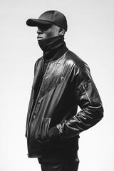 Black & white studio portraits of a fashionable young black man