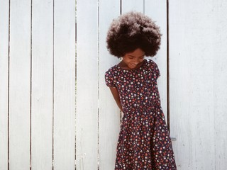 Little girl with big afro smiling