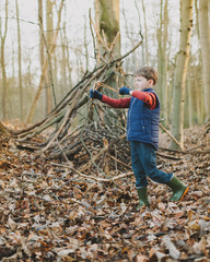 Boy playing in the woods