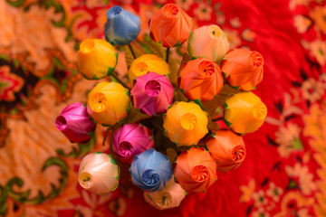 Artificial flowers made from colorful plastic.