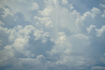Abstract scene of powerful moving white cloud with shades of blue sky background