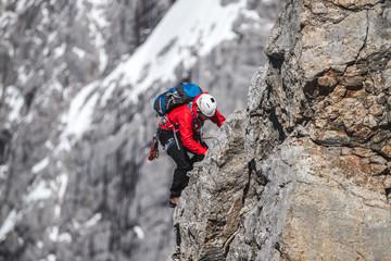 mountain climber in high alpine terrain