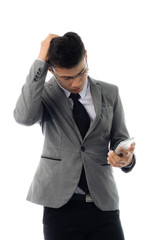 Portrait of a business man with glasses and smart phone. Isolated on white background