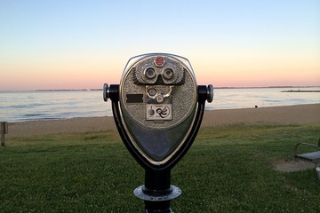 Sightseeing binoculars at the beach at sunset