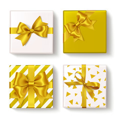 Set of decorative box with gold ribbons and golden bow for your design. New year holiday decoration. Vector objects isolated on white