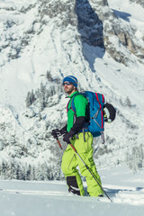 Portrait of a ski tourer in austian winter landscape