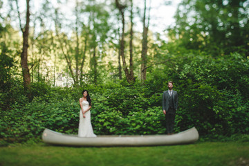Bride and Groom in Canoe on Land