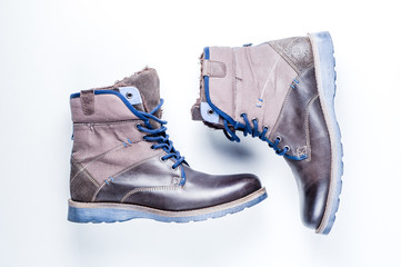 Mens winter boots on white background