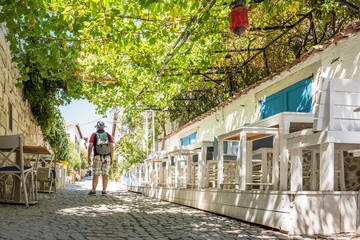 Man walking at Alacati charming Streets , a popular destination for traveling and vacation in Izmir,Turkey.26 August 2017.