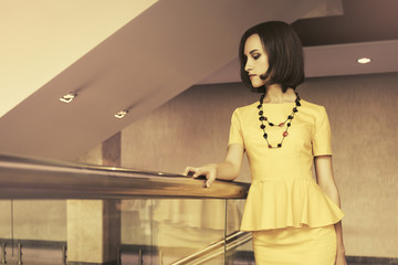 Young fashion business woman in office interior