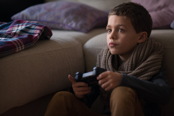 Boy playing video game at home at home