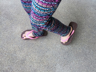 Sandal, Close Up on Girl's Violet Nail and Feet Wearing Pink Sandals on the Street Background Great For Any Use.