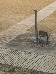 Chair under a beach shower. Barcelona, Spain.