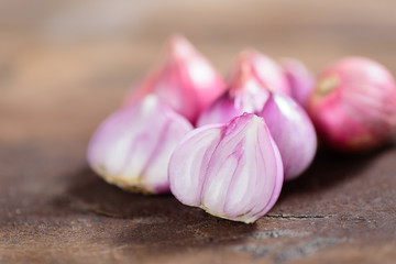 Slice shallots on wooden background for cooking,spice an herb,food ingredient