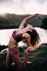 young woman doing yoga exercise outdoor