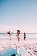 Happy female adult friends having fun at the beach