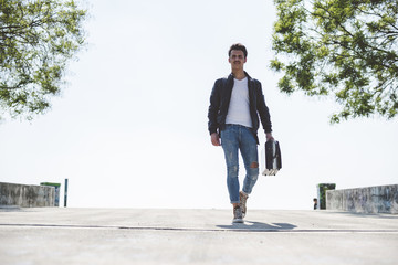 Young man walking with briefcase