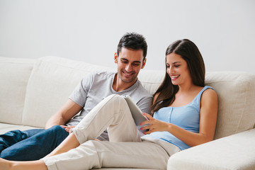 Happy Couple Using a Tablet at Home