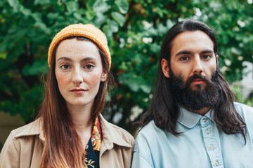 Portrait of young hipster couple in park.