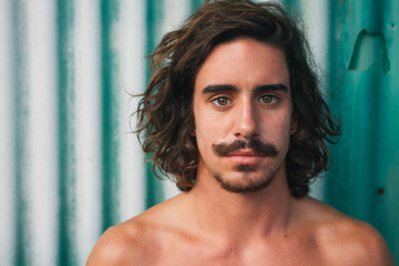 Surfer with moustache at a green background