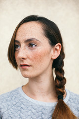 Portrait of beautiful freckled woman.