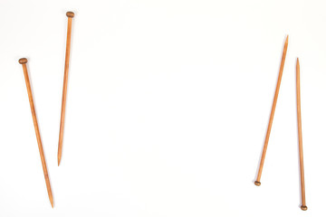 Wooden knitting needles on white background