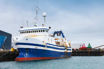 Industrial trawler ship stands moored in port