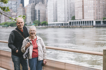 Portrait of Senior Mother and Adult Son Enjoying Park in New York's Roosevelt Island