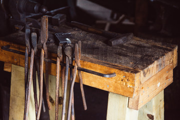 Rusty old tools in a blacksmith shop