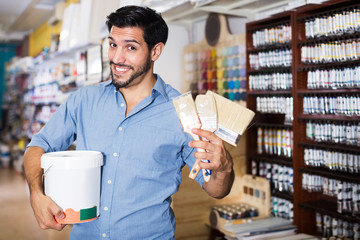 Male buyer in paint store