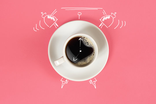 Clock. Cup of fresh espresso with clock sign on pink background