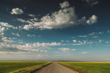 rural road with a fantastic sky with mystic clouds