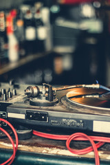 DJ equipment with turntable and mixing console