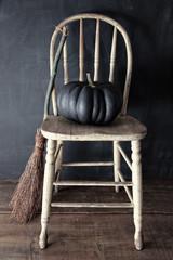Black pumpkin on chair