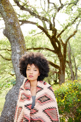 Portrait of African American woman relaxing in nature