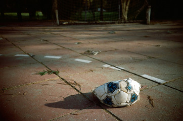 Deflated Soccer Ball in Court
