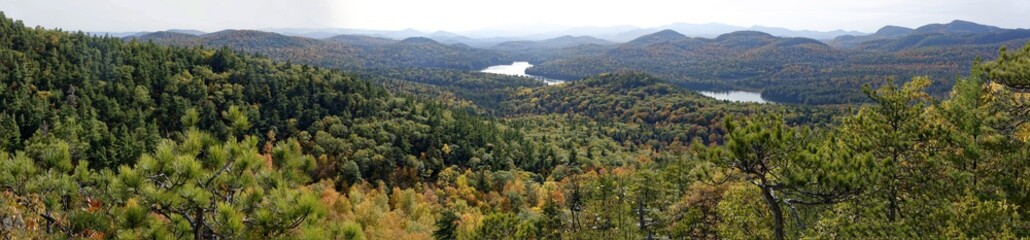 Panoramic view of mountains and a river in fall