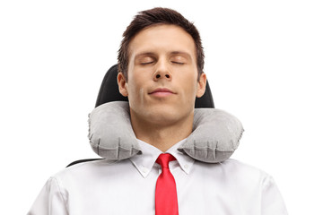 Formally dressed guy sleeping with a neck pillow