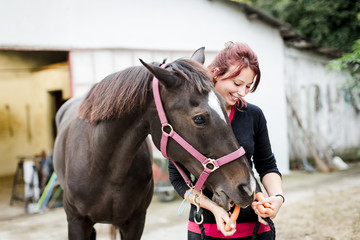 Woman and her horse at the stables
