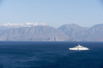 Photo sur Aluminium A super yacht at anchor on the Gulf of Mirabello off the Cretan town of Agios Nikolaos, Crete, Greece, October 2017