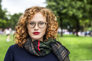 Portrait of redheaded young woman wearing glasses