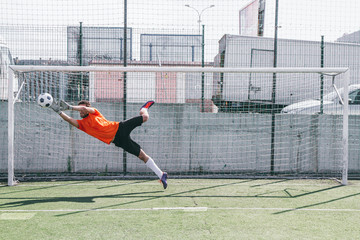 Goalkeeper stopping a ball during a soccer match