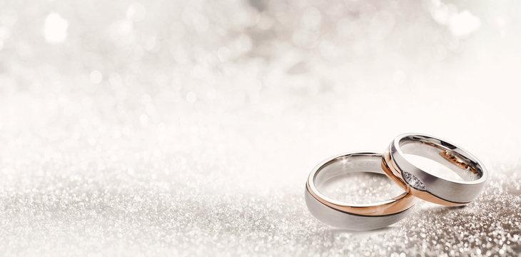 Designer wedding rings on a sparkling background