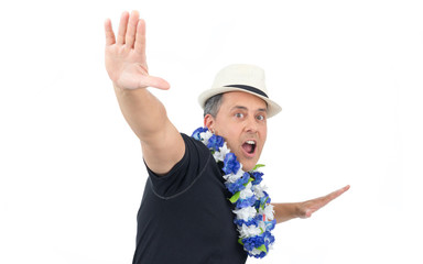 Man makes a crazy pose. He is overweighted and wearing a black polo shirt, flower necklace and a white panama hat..