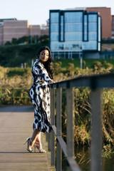 Pretty woman posing on path